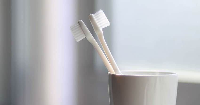 Toothbrushes in cup Synnott Lawline Dental Negligence